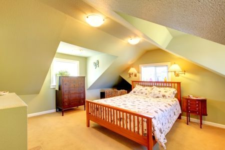 attic bedroom with green wall sandlargebed